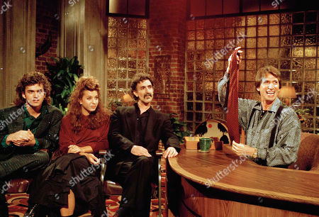 "Brenner Zappa Comedian David Brenner hosts avant garde fusion musician Frank Zappa, center, and his children, Dweezil, left, and Moon Unit, during a taping of Brenner's ""Nightlife"" talk show in New York. Brenner holds a necktie given to Frank Zappa upon entering a restaurant earlier in the day. On, publicist Jeff Abraham announced Brenner has died at the age of 78"