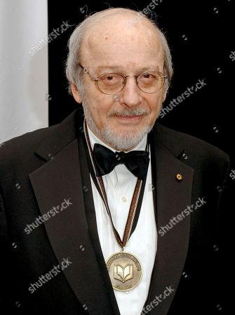 """E. L. Doctorow National Book Award finalist E.L. Doctorow poses for photos before the award ceremonies in New York. According to his son Richard Doctorow, the """"Ragtime"""" author died, in a New York hospital from complications related to lung cancer. He was 84. Doctorow reimagined the American past and applied its lessons to the present and future. Published in 1975, """"Ragtime"""" was later made into a film featuring James Cagney and a Broadway musical"""