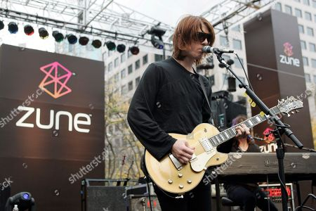 Stock Image of Benjamin Curtis Benjamin Curtis with the band Secret Machines performs at a launch party for Microsoft's new music player Zune at Westlake Park in downtown Seattle. Curtis, guitarist and co-founder of the popular indie-rock band School of Seven Bells, has died on Dec. 29, 2013, of cancer. He was 35