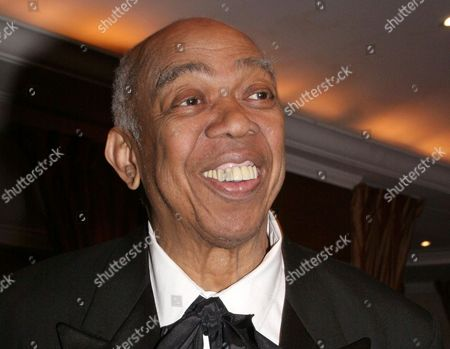 """Geoffrey Holder poses at the French Institute Alliance Francaise' """"La Nuit des Etoiles"""" dinner in New York, honoring French actress Catherine Deneuve. Holder, a Tony Award-winning director, actor, painter and choreographer who during an eclectic show business career led the groundbreaking show """"The Wiz"""" to Broadway, pitched 7-Up soda on TV and played a scary villain in the James Bond film """"Live and Let Die,"""" died Sunday of complications of pneumonia at Mount Sinai St. Luke' s Hospital in New York. He was 84"""