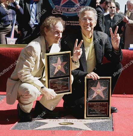 Ray Manzarek, Robbie Krieger Former Doors band members Ray Manzarek, right, and Robby Krieger display the stars they received on the Walk of Fame in the Hollywood section of Los Angeles. Manzarek, the keyboardist for the Doors has died at 74. Publicist Heidi Robinson-Fitzgerald says in a news release that Manzarek died, at the RoMed Clinic in Rosenheim, Germany, surrounded by his family