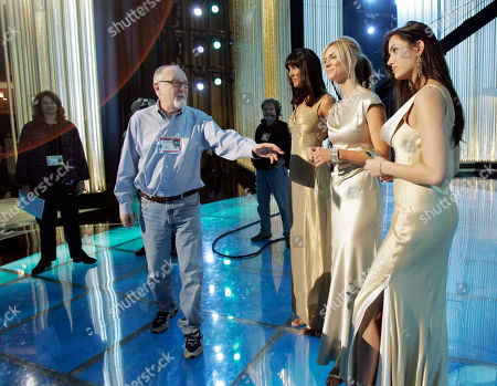 FOX Gil Cates, producer of the 77th Academy Awards, checks the lighting with award girls, from left, Donna Feldman, Amy Mueller and Jeanene Fox during rehearsals, for the Sunday telecast of the show from at the Kodak Theatre in Los Angeles