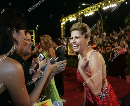 JARA Mexican singer Carmen Jara, laughs as she is interviewed on the red carpet before the Premio Lo Nuestro Latin music awards ceremony in Miami