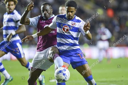 Stock Picture of Aston Villa's defender Aly Cissokho (28) fouls Reading FC striker (12) Gareth McCleary to give away a penalty during the EFL Sky Bet Championship match between Reading and Aston Villa at the Madejski Stadium, Reading