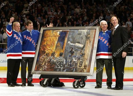 Former New York Rangers captain Mark Messier, right, is presented with a portrait from the Rangers 1994 Stanley Cup celebration during a pre-game ceremony to retire his No. 11, at New York's Madison Square Garden. He is joined by Rangers greats, from left, Rod Gilbert, Mike Richter and Eddie Giacomin