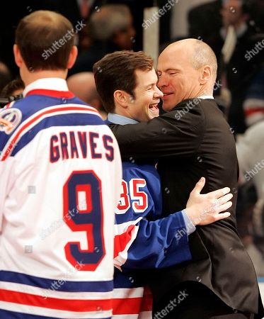 Former New York Rangers teammates Mark Messier and Mike Richter embrace during a pregame ceremony to retire Messier's No. 11, at New York's Madison Square Garden