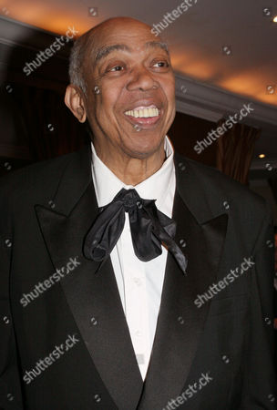 """HOLDER Geoffrey Holder poses for photographers at the French Institute Alliance Francaise' """"La Nuit des Etoiles"""" dinner, in New York. Catherine Deneuve was honored at the event"""