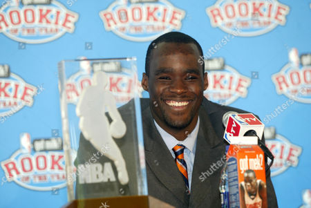 OKAFOR Charlotte Bobcats rookie Emeka Okafor smiles as he receives the Eddie Gottlieb Trophy after being named the 2004-05 Rookie of the Year, in Charlotte, N.C. on