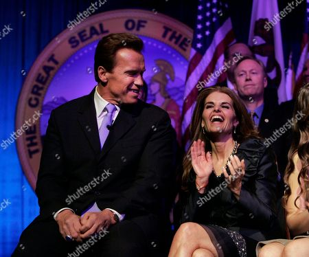 """Stock Image of Arnold Schwarzenegger, Maria Shriver Maria Shriver, wife of then Gov. Arnold Schwarzenegger laughs during his second inauguration in Sacramento, Calif. In an interview with """"60 minutes"""" that is scheduled to air Sunday, Schwarzenegger says the affair he had with longtime housekeeper Mildred Baena, that led to a son, was """"the stupidest thing"""", he ever did to Shriver who filed for divorce last July"""