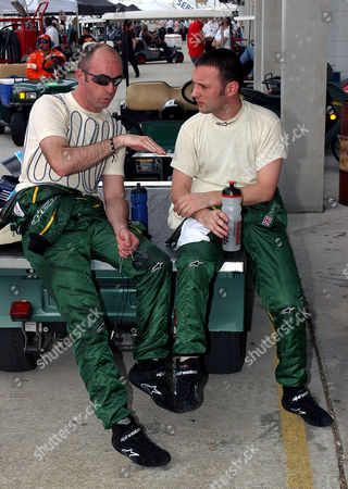 BRABHAM TURNER Aston Martin Racing team drivers David Brabham and Darren Turner, right, both from England, talk in the pit area during the afternoon practice for the American Le Mans Series 12 Hours of Sebring at the Sebring International Raceway, in Sebring, Fla. The 53rd running of the road race will take place Saturday