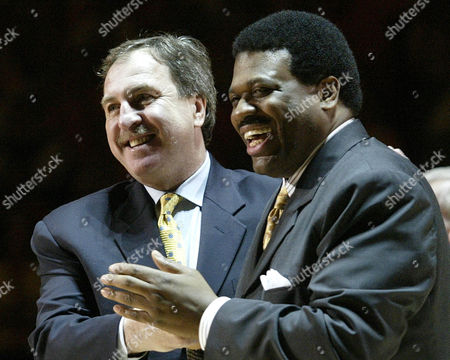 "Tennessee King Basketball Former Tennessee basketball players Bernard King, right, and Ernie Grunfeld, laugh during a ceremony to retire King's #53 jersey during halftime of the Tennessee-Kentucky game in Knoxville, Tenn. In an ESPN ""30 For 30"" documentary airing, about the friendship between King and Grunfeld, King publicly discusses for the first time incidents of racism he says he encountered while in college"