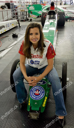 Ashley Force Drag racer Ashley Force, daughter of funny car race hero, John Force, poses on her dragster at her father's showroom in Yorba Linda, Calif