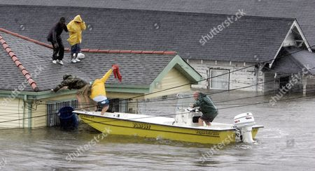 Stock Photo of Bryan Vernon and Dorothy Bell are rescued from their rooftop after Hurricane Katrina hit, causing flooding in their New Orleans neighborhood. The most destructive storm in U.S. history and also one of the deadliest, Katrina was a Category 3 storm with estimated maximum winds of 125 mph when it made landfall near Buras, La., on Aug. 29, 2005. Broken levees left most of New Orleans inundated. Damage was estimated at $75 billion, though rebuilding costs have far exceeded the initial damage. Katrina was blamed for around 1,200 deaths