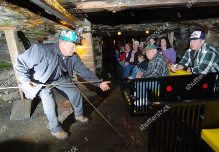 Stock Picture of George Archbald Beckley Exhibition Coal Mine tour guide and retired coal miner George Archibald demonstrates a tamping rod in Beckley, W.Va. during an underground tour. Doug Estepp, a Mingo County native, has launched a company that could be the first to share the rugged region's history with tourists. Coal Country Tours LLC is planning at least two tours for the summer of 2011, including a three-day West Virginia Mine War Tour in June