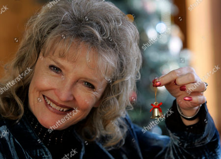 """Karolyn Grimes Karolyn Grimes who played """"Zuzu"""" in the movie """"It's a Wonderful Life"""" poses for a photo in Seneca Falls, N.Y"""