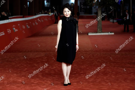 Stock Picture of Director Miwa Nishikawa poses for photographers as she arrives on the red carpet for the screening of the movie ' Nagai Iiwake ' (The Long Excuse) at the Rome Film festival in Rome