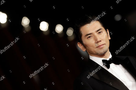 Actor Masahiro Motoki poses for photographers as he arrives on the red carpet for the screening of the movie ' Nagai Iiwake ' (The Long Excuse) at the Rome Film festival in Rome