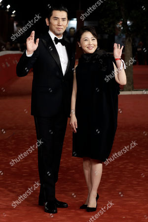 Director Miwa Nishikawa and Actor Masahiro Motoki pose for photographers as they arrive on the red carpet for the screening of the movie ' Nagai Iiwake ' (The Long Excuse) at the Rome Film festival in Rome