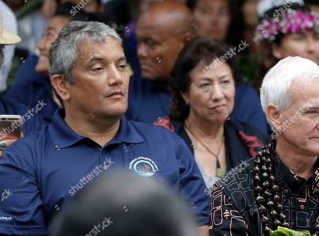 Billy Kenoi, Kirk Caldwell, Mike McCartney FILE ? In this photo, Hawaii County Mayor Billy Kenoi, left, attends ceremonies to welcome the Hawaiian voyaging canoe Hokulea in New York. Attorneys are expected to deliver their opening statements in Hawaii County Mayor Billy Kenoi's felony theft trial