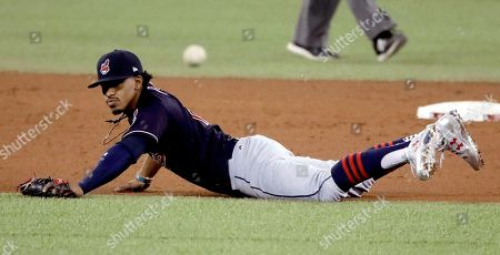 Cleveland Indians shortstop Francisco Lindor can't get a glove on a hit by Toronto Blue Jays' Michael Saunders during the sixth inning in Game 4 of baseball's American League Championship Series in Toronto