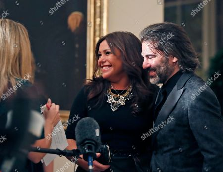 Rachael Ray, John Cusimano Rachael Ray, center, and her husband John Cusimano, speak with reporters as they arrive for a state dinner at the White House for Italian Prime Minister Matteo Renzi, in Washington