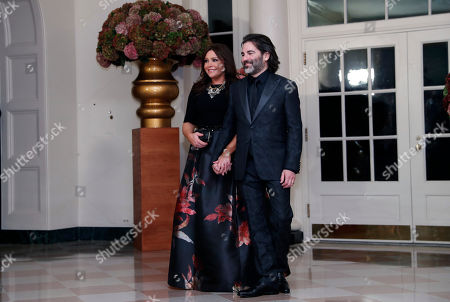 Rachael Ray, John Cusimano Rachael Ray, left, and her husband John Cusimano, arrive for a state dinner at the White House for Italian Prime Minister Matteo Renzi, in Washington