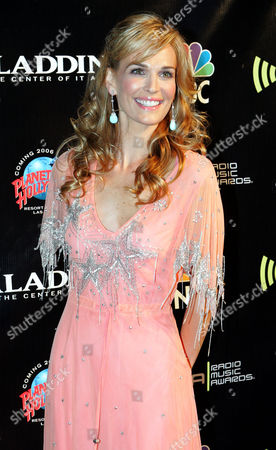 MOLLY SIMMS Actress and model Molly Sims walks the red carpet during The Radio Music Awards at The Aladdin Theatre for the Performing Arts, in Las Vegas