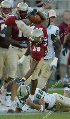 Stock Picture of BURKS DAVIS Alabama-Birmingham running back Dan Burks is stopped by Florida State's Buster Davis during first quarter action, in Tallahassee, Fla