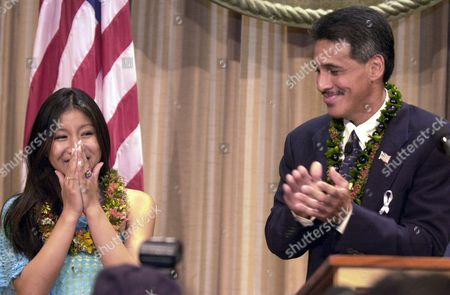 "TRIAS AIONA Jasmine Trias smiles as Lt. Gov. James ""Duke"" Aiona applauds during a ceremony in her honor at the Capitol, in Honolulu. Trias advanced this week to the final three on Fox's ""American Idol"