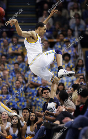HOLLINS UCLA's Ryan Hollins jumps into the crowd to retrieve a loose ball during the first half against Arizona, in Los Angeles