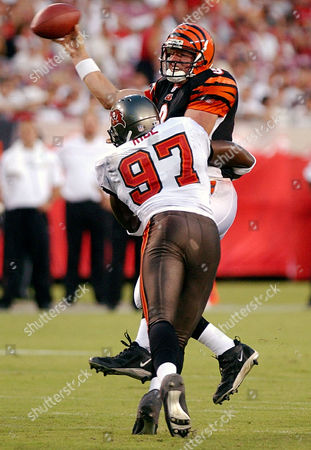 RICE PALMER Tampa Bay Buccaneers defensive end Simeon Rice (97) hits Cincinnati Bengals quarterback Carson Palmer as Palmer tries to get off a pass during the first quarter Monday night, at Raymond James Stadium in Tampa, Fla