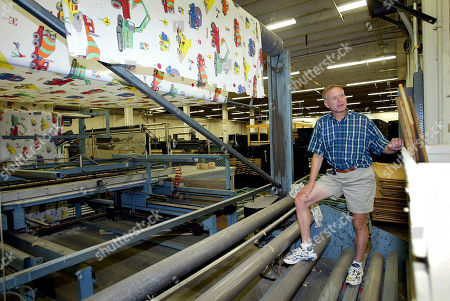 COTTER PMS AND THEREAFTER ** Tom Cotter stands near an abandoned machine with children's sheets inside the Pillowtex Plant No. 6 in Concord, N.C., . What happened to the hundreds of textile workers who once labored inside the plant is not lost on Cotter, who along with three partners has purchased the facility with ambitious plans to recycle it for use by manufacturers and other mixed-use tenants