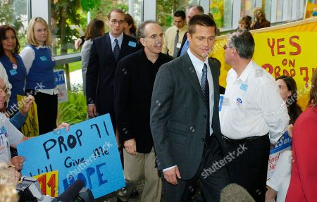 PITT ZUCKER Actor Brad Pitt, second from right, arrives at a news conference to express his support for Proposition 71, the California Stem Cell Research and Cures Initiative, at Children's Hospital Los Angeles, . Pitt also toured the hospital's stem cell laboratory. Behind Pitt is film producer/director and Proposition 71 co-chair Jerry Zucker