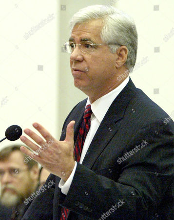 Stock Image of CONNOR Kenneth Connor, attorney for Gov. Jeb Bush, presents his argument before the Florida Supreme Court in the Bush v. Schiavo case, in Tallahassee, Fla. The question before the court is whether the law Bush signed in October to keep the 40-year-old Schiavo alive violates her constitutional right to privacy and the separation of government powers. Terri Schiavo's husband, Michael, wants the feeding tube removed from his wife
