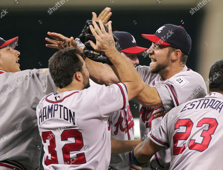 ORTIZ Atlanta Braves pitcher John Smoltz, right, celebrates with teammates Johnny Estrada (23) Mike Hampton (32) and Russ Ortiz, left, after beating the Houston Astros in Game 4 of their National League Division Series in Houston. The Braves beat the Astros 6-5 to tie the best-of-series at 2-2