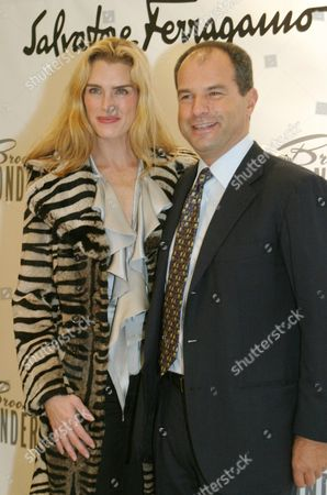 """Brooke Shields, left, and Massimo Ferragamo pose for photographers as Shields arrives at the Welcome Back to Broadway Party in her honor hosted by Ferragamo at Ferragamo's on New York's Fifth Avenue . Shields has returned to Broadway in the starring role of Ruth Sherwood in the musical """"Wonderful Town"""