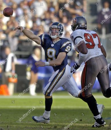 BREES RICE San Diego Chargers quarterback Drew Brees throws on the run as he is pursued by Tampa Bay Buccaneers' Simeon Rice during the Chargers; 31-24 victory in San Diego. Brees was 17 of 23 for 220 yards and two touchdowns