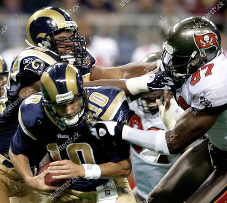 RICE BULGER PACE St. Louis Rams quarterback Marc Bulger (10) is sacked for a 6-yard loss by Tampa Bay Buccaneers' Simeon Rice (97) in the second half Monday night, in St. Louis. Attempting to block for Bulger is offensive lineman Orlando Pace. The Rams won 28-21