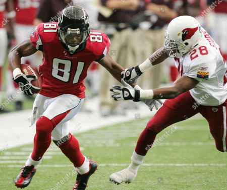 Stock Photo of CARDINALS FALCONS Atlanta Falcons wide receiver Peerless Price (81) takes it to first-and-ten under pressure from Arizona Cardinals cornerback Duane Starks (28) during first half play at the Georgia Dome in Atlanta