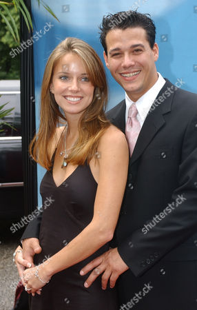 CBS Survivor: All-Stars Amber Brkich and her fiance Rob Mariano arrives for the 2004-2005 prime-time season unveiling, in New York