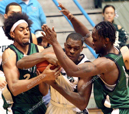 DAVIS WITHERS ITI Tulane's Quincy Davis, center, battles Charlotte's Martin Iti (2) and Curtis Withers (3), right, for a rebound during the first half in New Orleans