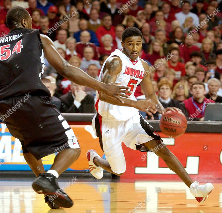 DEAN MAXIELL Louisville's Taquan Dean drives around Cincinnati's Jason Maxiell during the second half of Louisville's 77-70 win, in Louisville, Ky. Dean led his team in scoring with 19 points to go along with four assists and two steals