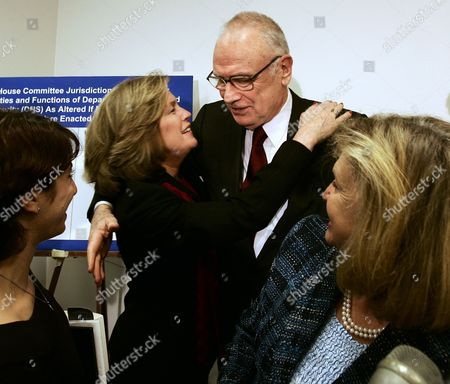 HAMILTON LEMACK MALLONEY Lee Hamilton, co-chairman of the Sept. 11 Commission, hugs Mary Fetchet at a press conference with family members of Sept. 11 victims regarding the intelligence reform bill recently passed by Congress in the U.S. Capitol . Fetchet lost her son in the Sept. 11 attacks. At left is Carie Lemack, who lost her mother and at right is Rep. Carolyn Maloney, D-N.Y