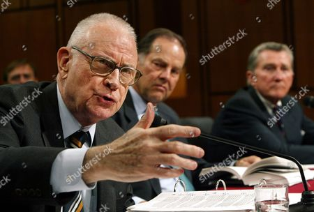 Stock Image of HAMILTON KEAN LEHMAN September 11 commission vice chairman Lee Hamilton, left, Thomas Kean, center, commission chairman, and Commissioner John Lehman, right, testify before the Senate Intelligence Committee Open Hearing on 9/11 Commission Recommendations, on Capitol Hill, in Washington