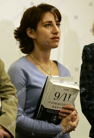 LEMACK Carie Lemack, of Framingham, Mass., a member of the Sept. 11 Family Steering Committee, holds a copy of the 9/11 Commission report as she participates in a press conference with fellow committee members where they spoke about the Intel Reform Bill and their efforts to overcome what they say is opposition to intelligence reform legislation within the House Republican leadership, at the U.S. Capitol in Washington . She lost her mother Judy Larocque, who was a passenger on American Airlines flight 11 which struck the World Trade Center