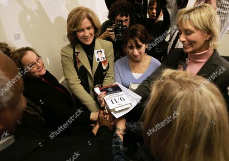 ECKERT Members of the 9/11 Family Steering Committee holds hands with a copy of the 9/11 Commission report at the end of a news conference where they spoke about the Intel Reform Bill and their efforts to overcome what they say is opposition to intelligence reform legislation within the House Republican leadership, at the U.S. Capitol in Washington . Left to right are Carol Ashley, Mary Fetchet, Carie Lemack, and Beverly Eckert