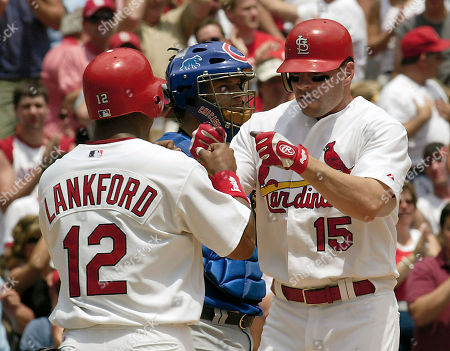 EDMONDS LANKFORD BARRETT St. Louis Cardinals Jim Edmonds, right, is greeted at home plate by teammate Ray Lankford, as Chicago Cubs catcher Michael Barrett looks away, after hitting a two-run home run in the first inning at Busch Stadium in St. Louis