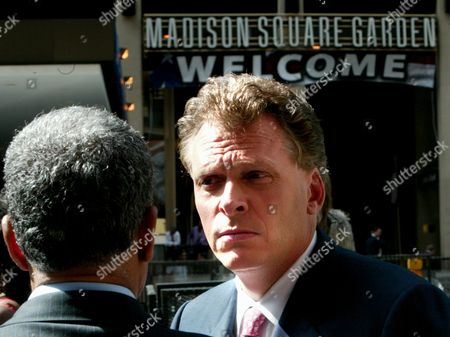 Terrence McAuliffe, right, chairman of the Democratic National Committee, talks with NPR's reporter Juan Williams outside the Republican National Convention at Madison Square Garden in New York