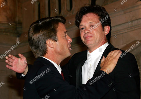 EDWARDS MELLENCAMP Sen. John Edwards, D-N.C., left, greets musician John Cougar Mellencamp at a party at the Wang Theater in Boston, on . Edwards had just completed his address to the 2004 Democratic National Convention