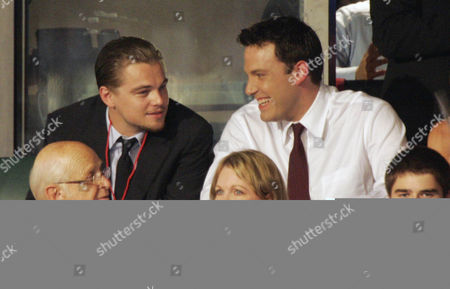 Actors Leonardo DiCaprio, top left, and Ben Affleck, top right, talk to eachother during the Democratic National Convention in Boston, . From left at bottom are Producer Norman Lear, his wife Lyn Davis and Lear's grandson Ben Lear